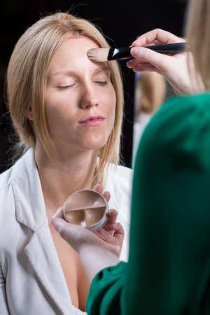 visagiste: Visagiste making up face of beauty woman Stock Photo