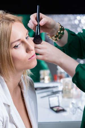 visagiste: Make up artist doing makeup test before wedding
