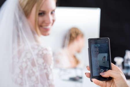 happy wedding: Bride having taken photo at visage studio