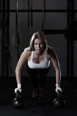 Woman with strong arms at the gym Stock Photo