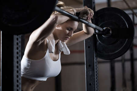 workout: View of tired girl after weight lifting Stock Photo