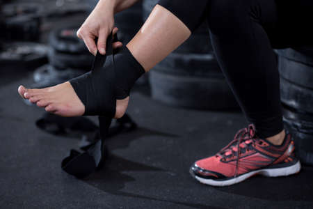 beautiful ankles: Girl with ankle injury preparing to workout