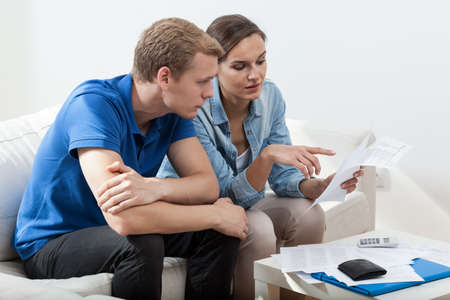 unpaid: Poor young marriage reading high unpaid bills