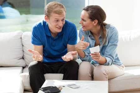 couple talking: Portrait of young couple not having money