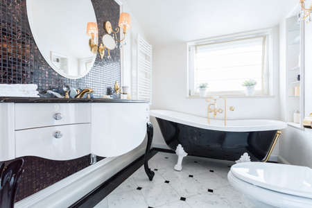 bathtub: View of black and white baroque bathroom Stock Photo