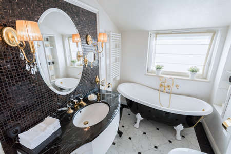 View of bright bathroom in baroque style photo