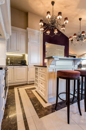 Kitchen in baroque style inside expensive house Archivio Fotografico