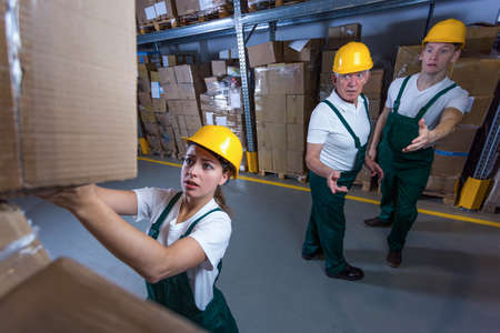 stockroom: Image of young woman working in storehouse