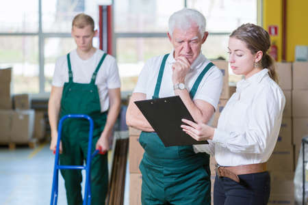 storeroom: Image of manager talking with warehouse worker