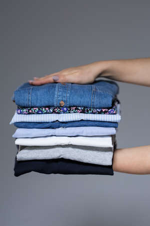 View of female hands with ironed clothes Standard-Bild