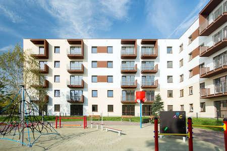 Public square for children in front in housing development