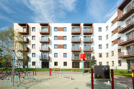 housing development: Public square for children in front in housing development