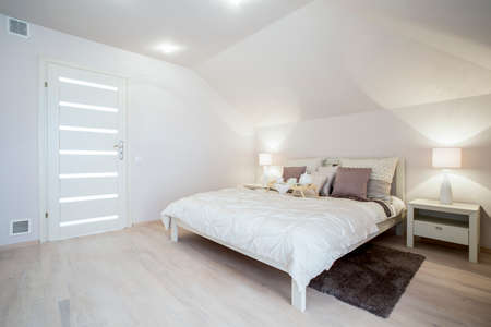 Bright delicate bedroom with spacious bed, horizontal photo