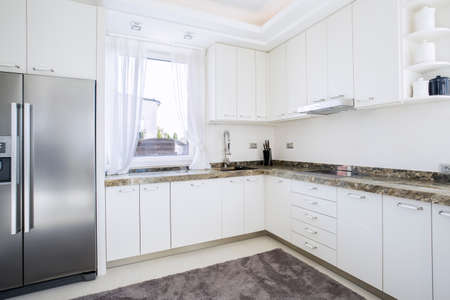 Horizontal view of kitchen with marble worktop photo