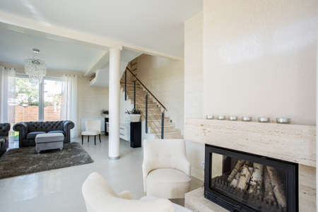 Horizontal view of modern interior with fireplace