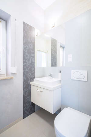 View of elegant bathroom in new house photo
