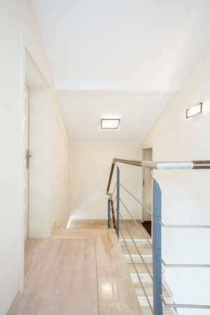 entresol: Bright corridor upstairs in new house, vertical Stock Photo