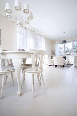 interior designer: Modern white light dining room inside the apartment