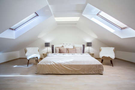 bedroom furniture: Bright attic bedroom in the fashionable apartment
