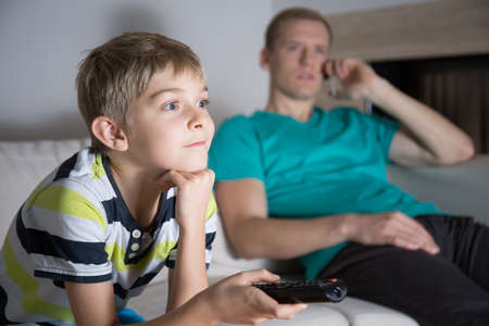 tv home: Image of schoolboy addicted to watching tv Stock Photo