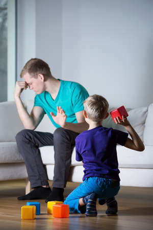 Father doesnt want to play with his son photo