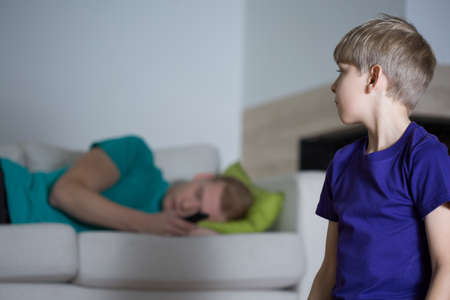 depressed person: Sleeping dad and child staying without care