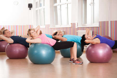 swiss ball: Close-up of pilates exercise with fitness balls