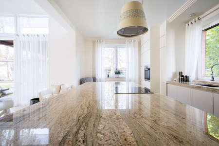 worktop: Granite worktop inside white light apartment