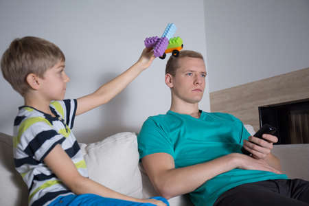 Young dad do not care about his son photo