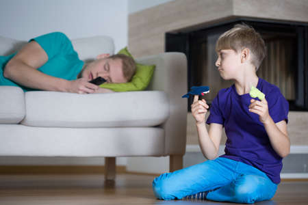 needing: Image of sad child needing dads attention Stock Photo