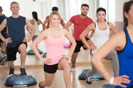 sport training: Training on the bosu in fitness club Stock Photo
