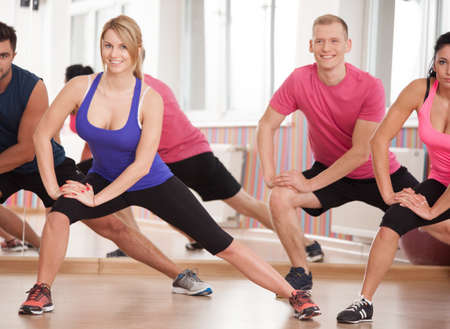 physical education: Fit friends training together at the gym