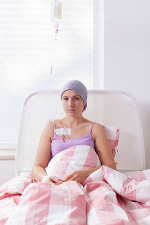woeful: Girl suffering from tumor being in hospital Stock Photo