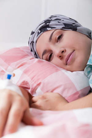 bald girl: Girl with leukaemia lying in hospital bed