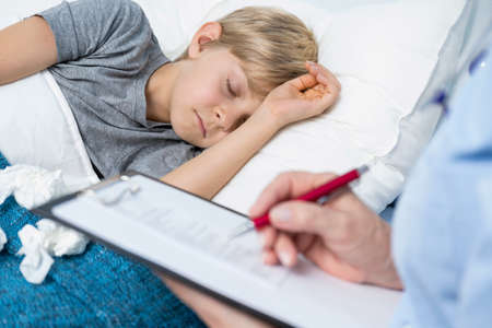 sick kid: Sick little boy sleeping in his hospital bed