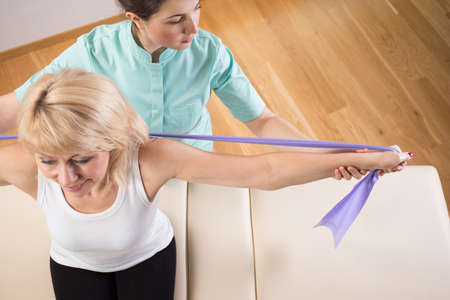 color therapy: View from the top of physiotherapist exercising with patient Stock Photo