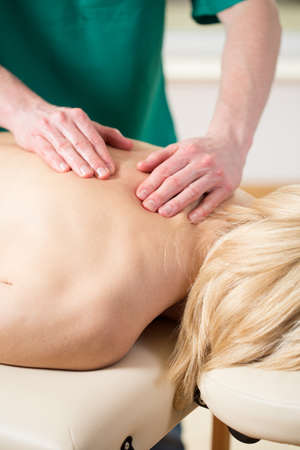 spinal manipulation: Close-up of masseur doing thoracic spine massage Stock Photo