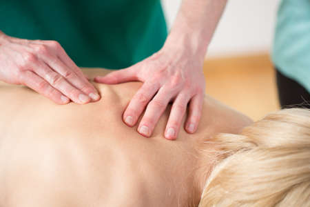 spinal manipulation: Close-up of rubbing the muscles during the massage