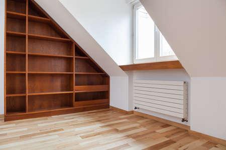 attic: View of empty bookshelf in the attic