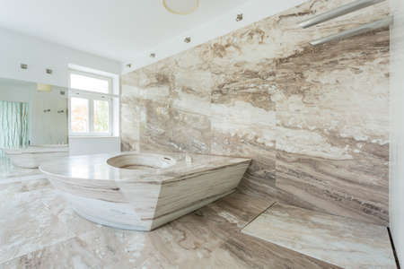 furniture: Interior of luxury bathroom with marble tiles