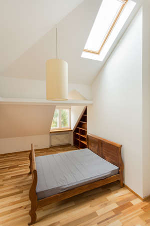 Photo from the top of empty wooden bedroom photo