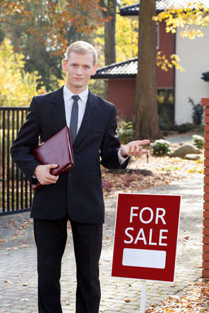 real estate agency: Photo of real estate agent waiting for clients