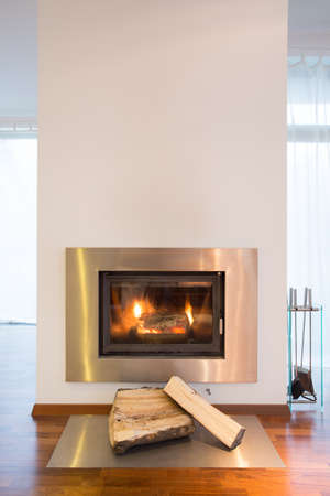 living rooms: Close-up of burning fireplace in detached house Stock Photo