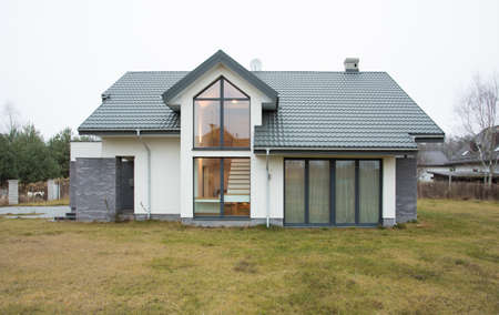 Exterior view of detached house at autumn time 스톡 콘텐츠