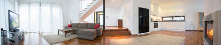 stairs interior: Panoramic view of modern interior with living room and kitchen Stock Photo