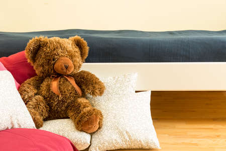 Close-up of little brwon teddy in children room photo
