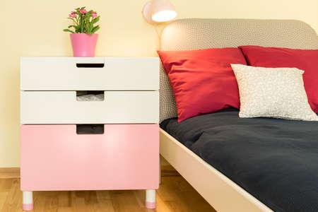 nightstand: Close-up of esthetic white nightstand in children room Stock Photo