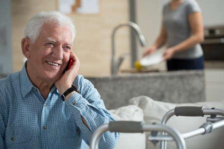 携帯電話の話高齢者の病気の人 写真素材
