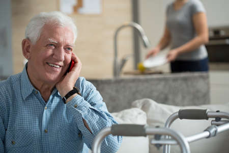 hospital care: Elderly sick man talking the mobile phone