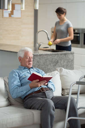 Elderly sick man resting on the couch at home